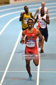 US Calvin Smith crosses the finish line to win in the Men 4 x 400 ...