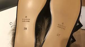gucci black princetown leather fur slip