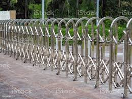 Stainless Steel Barrier Gate Or Folding Fence Gate With Wheel On Cement Ground For Protection In External Traffic That Blocks The Road Stock Photo Download Image Now Istock