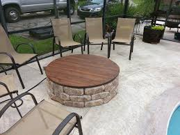 firepit with a gas insert and a wooden