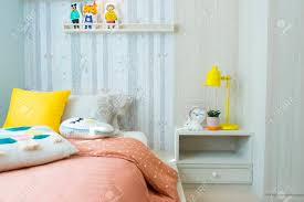 Kid Bedroom With Cute Pillows And Yellow Table Lamp On Side Table Stock Photo Picture And Royalty Free Image Image 140691979