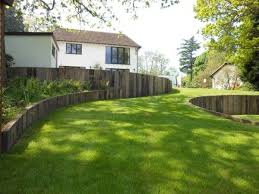 curved timber retaining wall hillside
