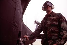 Spec. 4 Byron Hill, 854th Supply and Service Company, Utah National Guard,  refuels a UH-60