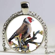 small bird glass time stone pendant