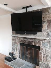 tv ceiling mount above fireplace with