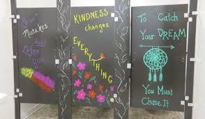 teachers paint bathroom stalls to inspire students