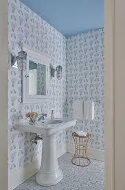 wallpaper with white pedestal sink