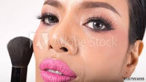applying closeup cosmetic powder brush