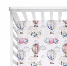 airplane and hot air balloon crib sheet
