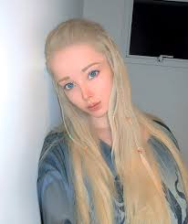 woman dubbed the human barbie posts