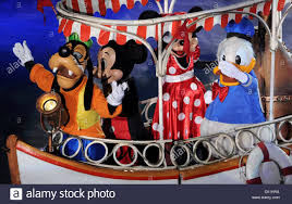 Ice scaters dressed as Goofy, Minnie Mouse, Mickey Mouse and ...