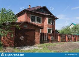 Red Two Storey Brick House With Garage Behind High Fence Stock Image Image Of Decker Garage 142336659