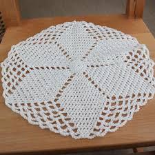 white round handmade crochet tablecloth