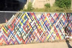 Fence Art 25 Pieces Of Art Using A Backyard Fence As The Canvas 100 Things 2 Do Fence Art Garden Fence Art Fence Decor