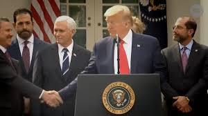 Coronavirus: Donald Trump shakes hands ...