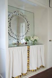 nook with skirted makeup vanity and