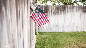 American Flag On A Fence Photo Lightstock