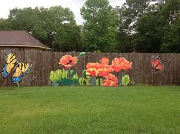 What A Great Way To Brighten Up Your Fence Now You Don T Need To Plant Any Flowers By Lori Anselmo Gomez On Faceb Fence Art Garden Fence Art Garden Mural
