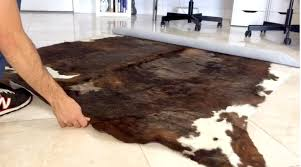 how to keep a cowhide rug from sliding