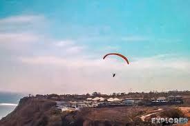 paragliding in gunung payung beach explorervibes