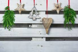 Christmas Ornaments Hanging Against White Id 96905284