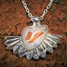 peacing together silver dove pendant