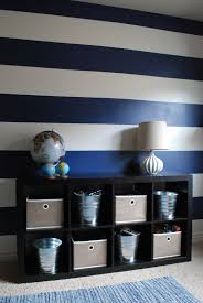 These Classic White And Navy Stripes Will Bring That Nautical Feel To Any Room Paintzen Striped Accent Walls Striped Walls Toddler Boys Room