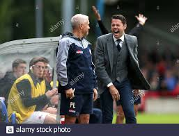 Accrington Stanley's manager James Beattie (right) has a laugh during the  match Stock Photo - Alamy