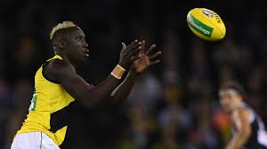 Mabior Chol on his dyed hair ...