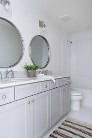 round mirrors over gray dual bath