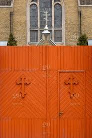 Church Fence Wooden Gate In Orange With Crosses Building Old Church Architecture Door Wood Entrance Gate Fence Vintage Wooden Stone Antique Background Design Wall Decoration Doorway Ancient Traditional Plank Texture Exterior