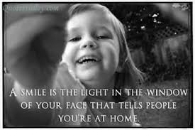 a smile is the light in the window quote collection of inspiring