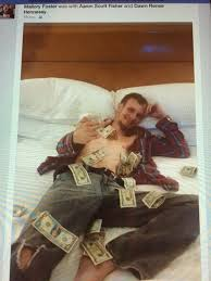 Aaron Fisher's Family Posts Facebook Photo of Him Laying In Cash & Giving  Middle Finger | The Framing of Joe Paterno