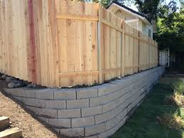 Retaining Wall With Fence On Top Backyard Retaining Walls Fence Design Backyard Fences