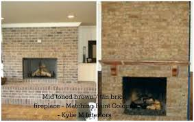 brown painted brick fireplace these tan