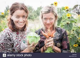 Abigail Sullivan and Kasha Rigby with some vegitables from their Stock  Photo - Alamy