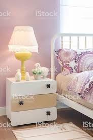 Yellow Lamp On Wooden Table In Kids Bedroom Stock Photo Download Image Now Istock
