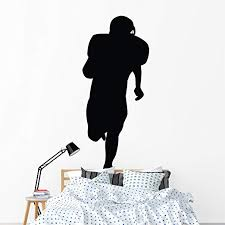 Amazon Com Wallmonkeys Running Back Football Silhouette Wall Decal Peel And Stick Graphic 72 In H X 29 In W Wm208460 Home Kitchen