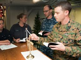 File:US Navy 111220-N-PB383-542 Hospitalman Aaron Seltzer, assigned to the  11th Marine Expeditionary Unit (11th MEU), lights a Menorah in observance  of.jpg - Wikimedia Commons