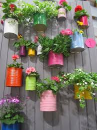 Paint Recycled Cans The Colours Of The Rainbow And Hook To Your Fence Easy Herb Garden Check Out The Cute Garden Ideas Vintage Garden Decor Garden Projects