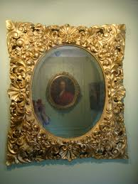 large baroque mirror carved and gilded