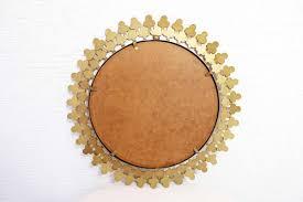 vintage metal clover sunburst mirror