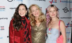 Jerry Hall makes rare public appearance with lookalike daughters ...
