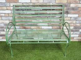 green curved two seater garden bench