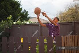 Boy Throwing Basketball Near Fence Sport Ca Stock Photo 171688398