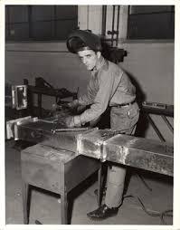 "Graduate of the Sheet Metal Department, John Loonie"" by New York Trade  School"