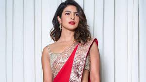 Priyanka Chopra's red Abu Jani Sandeep Khosla sari came with a sexy strappy  mirror work blouse | VOGUE India