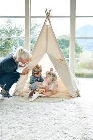 Mom And Kids Playing In Teepee Tent In Living Room By Trinette Reed Stocksy United