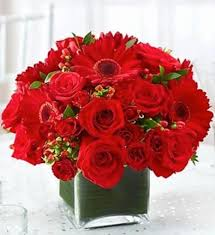 all red centerpiece in a vase in