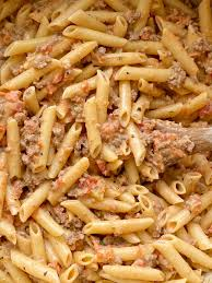 creamy tomato beef pasta together as